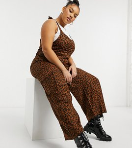 Read more about Native youth plus tie shoulder oversized dungaree jumpsuit in leopard-beige