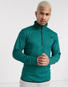 Read more about New balance running tenacity quarter zip mid-layer in green