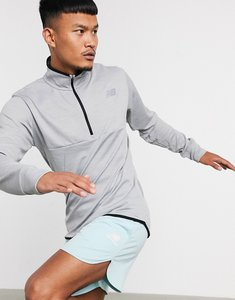 Read more about New balance running tenacity quarter zip mid-layer in grey-black