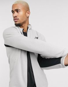 Read more about New balance running tenacity zip thru track jacket in grey