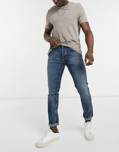 Read more about Nudie jeans co grim tim slim straight fit jeans in indigo feeling-blue