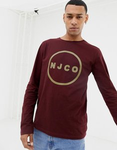 Read more about Nudie jeans co orvar long sleeve logo t-shirt in plum-purple