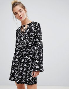 Read more about Qed london floral wrap front dress with tie detail-black