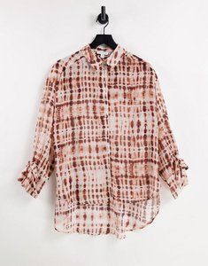Read more about Sheer tie dye print oversized shirt in rust-red