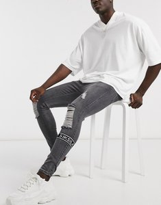 Read more about Siksilk skinny jeans with ripped knee and logo in washed black