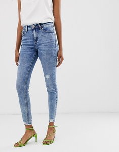 Read more about Stradivarius join life skinny low waist jeans in light wash-blue