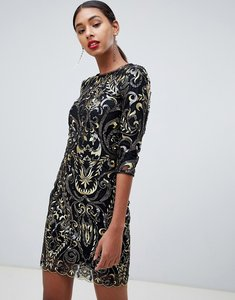 Read more about Tfnc patterned sequin mini bodycon dress with scallop open back in black-multi