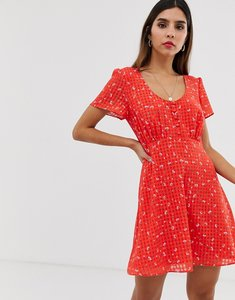 Read more about The east order aggy floral mini dress with button detail-red