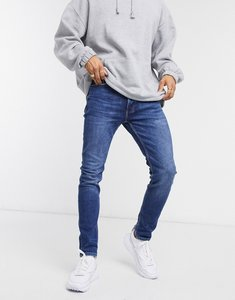 Read more about Topman skinny jeans in mid wash-blue