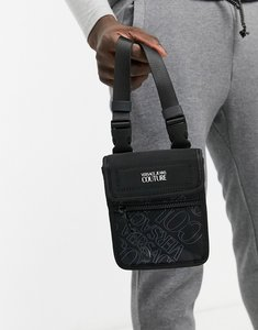 Read more about Versace jeans couture flightbag with purple logo print in black