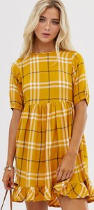 Read more about Wednesday s girl mini dress in oversized check print-orange