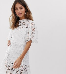 Read more about White sand cutwork lace mini skater dress with peplum hem in ivory