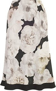 Read more about Chesca contrast trim rose print skirt blush