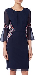 Read more about Raishma pleated sleeve floral dress navy