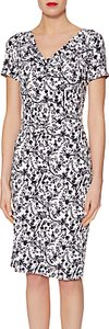 Read more about Gina bacconi floral jersey dress navy white