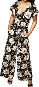 Read more about Yumi flower print jumpsuit black