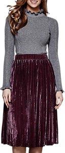 Read more about Yumi pleated velvet midi skirt