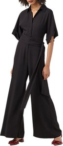 Read more about Finery meadow tie waist jumpsuit black