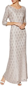 Read more about Gina bacconi holly lace long sleeve maxi dress beige