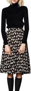Read more about Compa a fantastica flower print midi skirt black