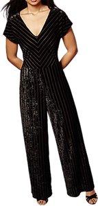 Read more about Yumi velvet panelled v neck wide leg pinstripe jumpsuit black