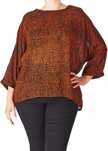 Read more about Adia slit back printed blouse orange rust