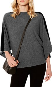 Read more about Karen millen velvet knitted poncho dark grey