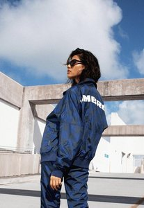 Read more about Umbro x missguided navy oversized batwing track top blue