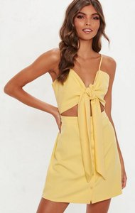 Read more about Yellow tie front cut out button down mini dress yellow