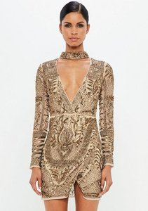 Read more about Gold choker neck embellished wrap dress brown
