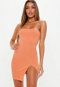 Read more about Peach bandeau ribbed thigh split mini dress pink
