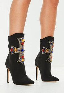 Read more about Black cross embellished stretch ankle boots black