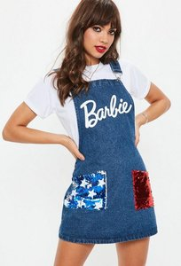 Read more about Barbie x missguided blue denim american flag dungaree mini dress blue