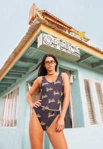 Read more about Barbie x missguided black printed swimsuit black