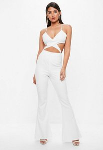 Read more about White strappy cross front cut out flare leg jumpsuit white