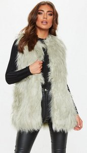 Read more about Mint green faux fur gilet green