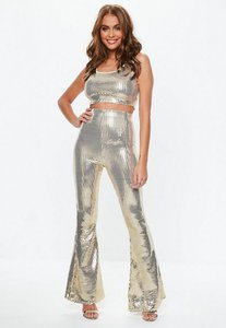 Read more about Gold kick flare trouser and scoop crop top co ord set gold
