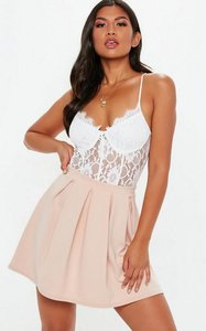 Read more about Nude box pleat mini skirt beige