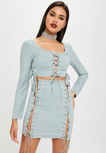 Read more about Carli bybel x missguided blue lace up crop top blue