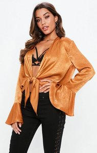 Read more about Rust tie front flute sleeve satin blouse brown