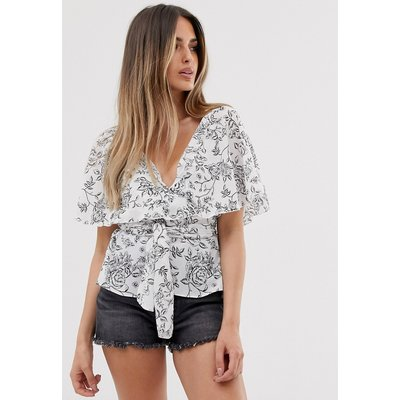 ASOS DESIGN short sleeve sheer wrap top with cape detail in floral print