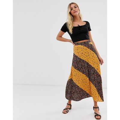 ASOS DESIGN button side city maxi skirt in mixed ditsy floral