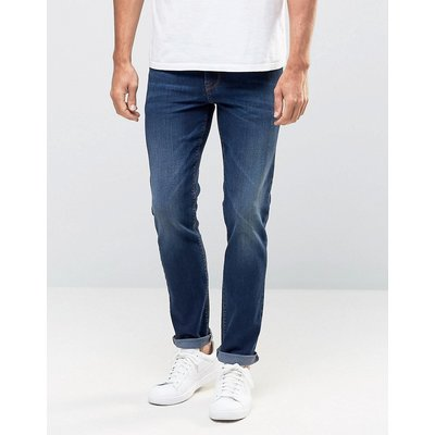 Jeans Sale - ASOS - Enge Jeans in dunkler Waschung - Blau