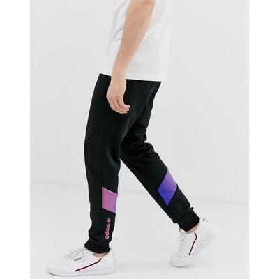 ADIDAS adidas Originals - Schwarze Trainingshose mit Grafikprint - Schwarz