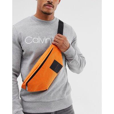 CALVIN KLEIN Calvin Klein - Item Story - Gürteltasche in Orange mit Logo - Orange