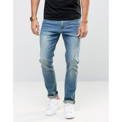 Jeans im Sale - ASOS - Enge Jeans in mittlerer Waschung - Blau