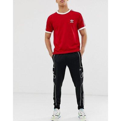 ADIDAS adidas Originals - Flamestrike - Jogginghose mit fließendem 3-Streifendesign in Schwarz - Schwarz