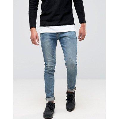 Jeans im Sale - ASOS - Röhrenjeans in mittelblauer Waschung - Blau
