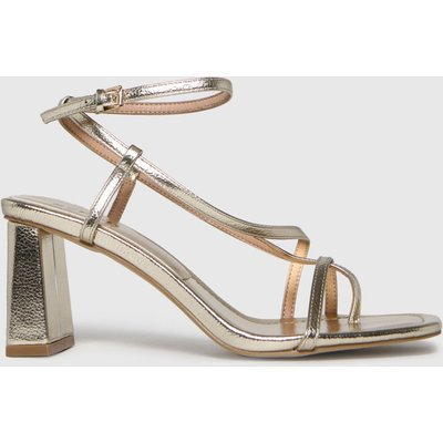 Schuh Gold Storm Strappy Sandal High Heels