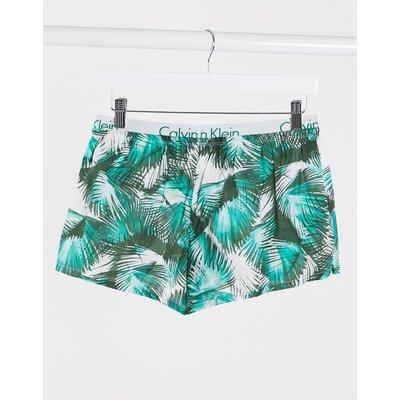 Calvin Klein – Pyjama-Shorts mit Palmenprint-Grün
